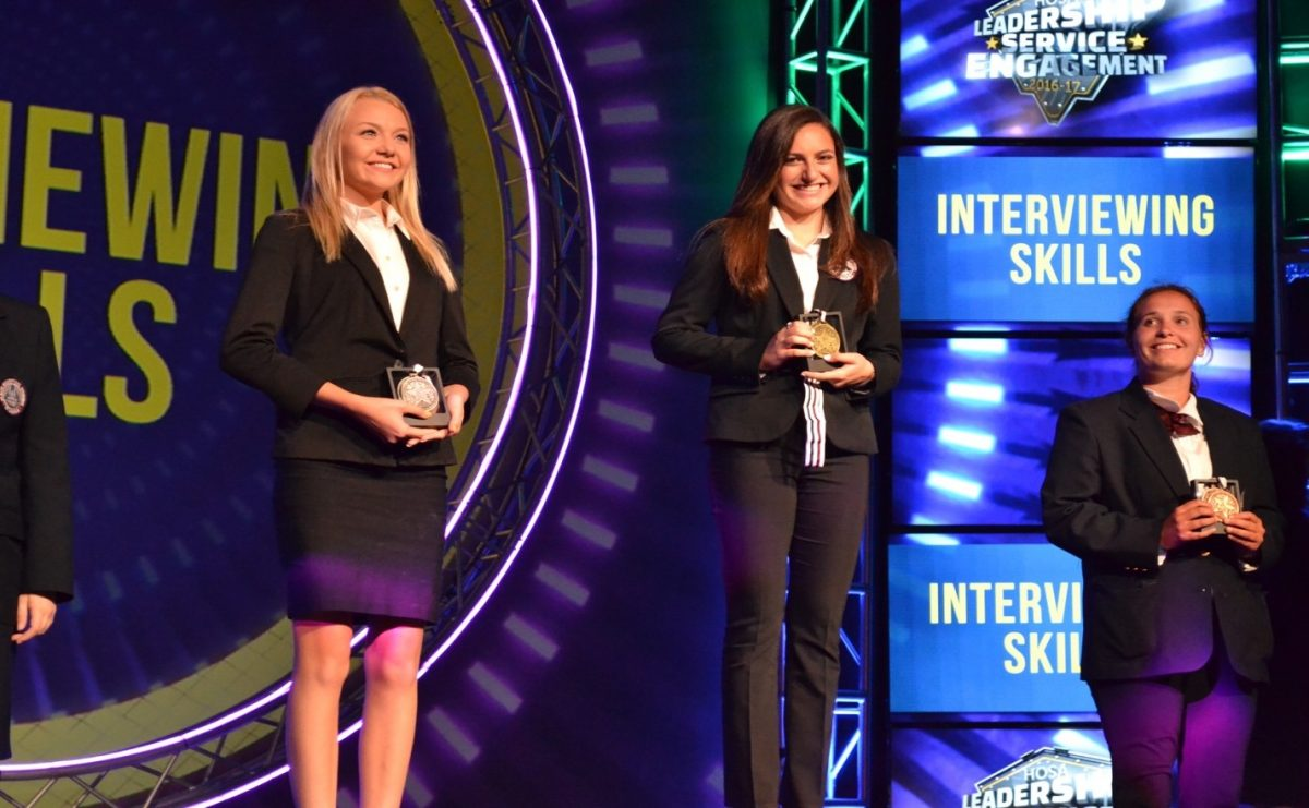 Sophie Ginsberg (Center) at the international HOSA competition.