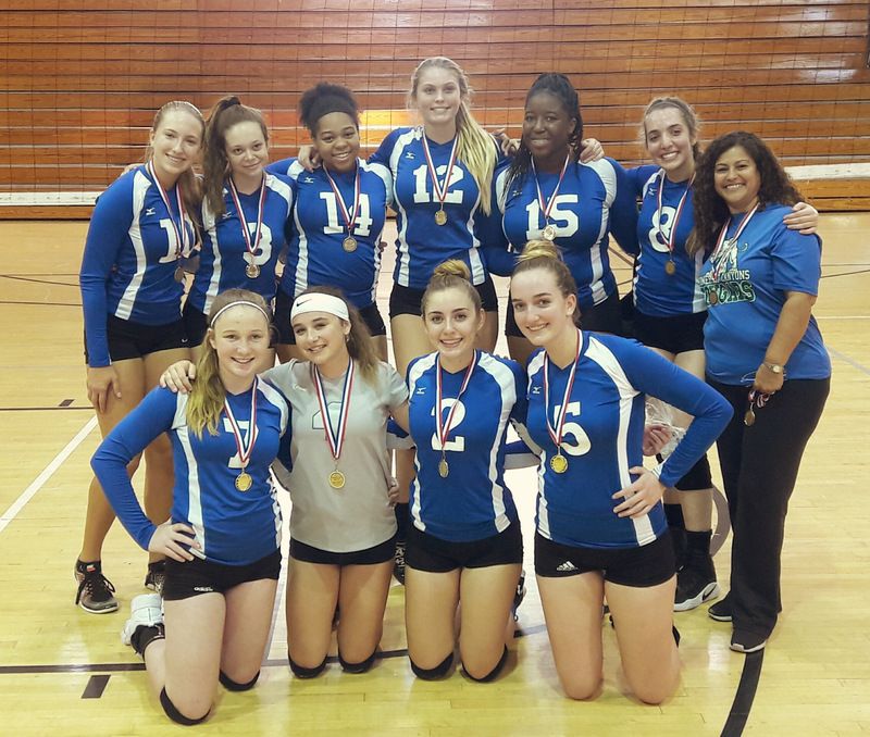 The Varsity Girls Volleyball team takes a group picture after winning second place in the gold division of the Palm Beach Classic tournament.