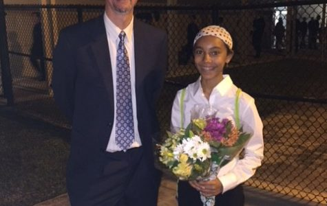 Jayden Noel took a moment to enjoy her accomplishments with Mr. Dunn.