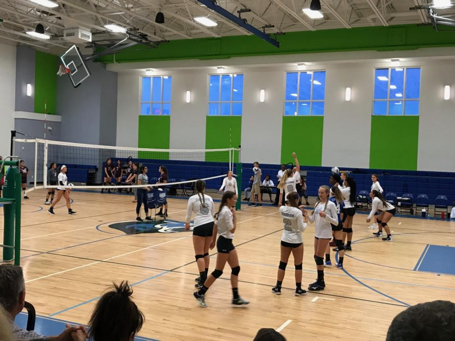 Here, our varsity players practice before going against the TCA Warriors.