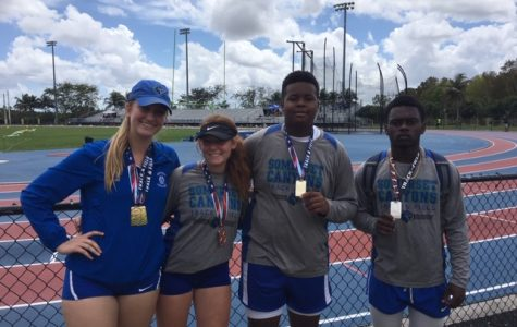 (Left to right) Cara Salsberry, Kassidy Rubin, Tre'main Robinson, and Jobed Phanord show off their new medals.