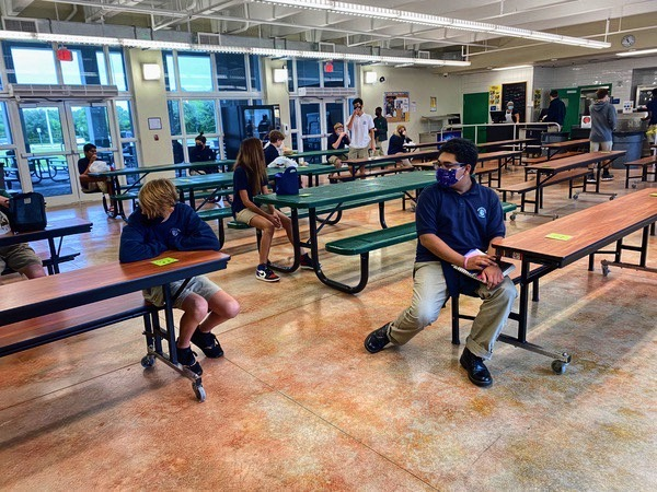 Students must socially distance themselves in the cafeteria and classrooms for safety purposes.