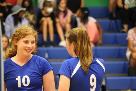 Seniors Rachel Feierstein and Katie Jankun encourage each other on the court in their September 21 game against Olympic Heights.